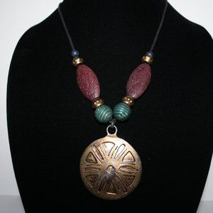 Beautiful gold medallion cord necklace 32""